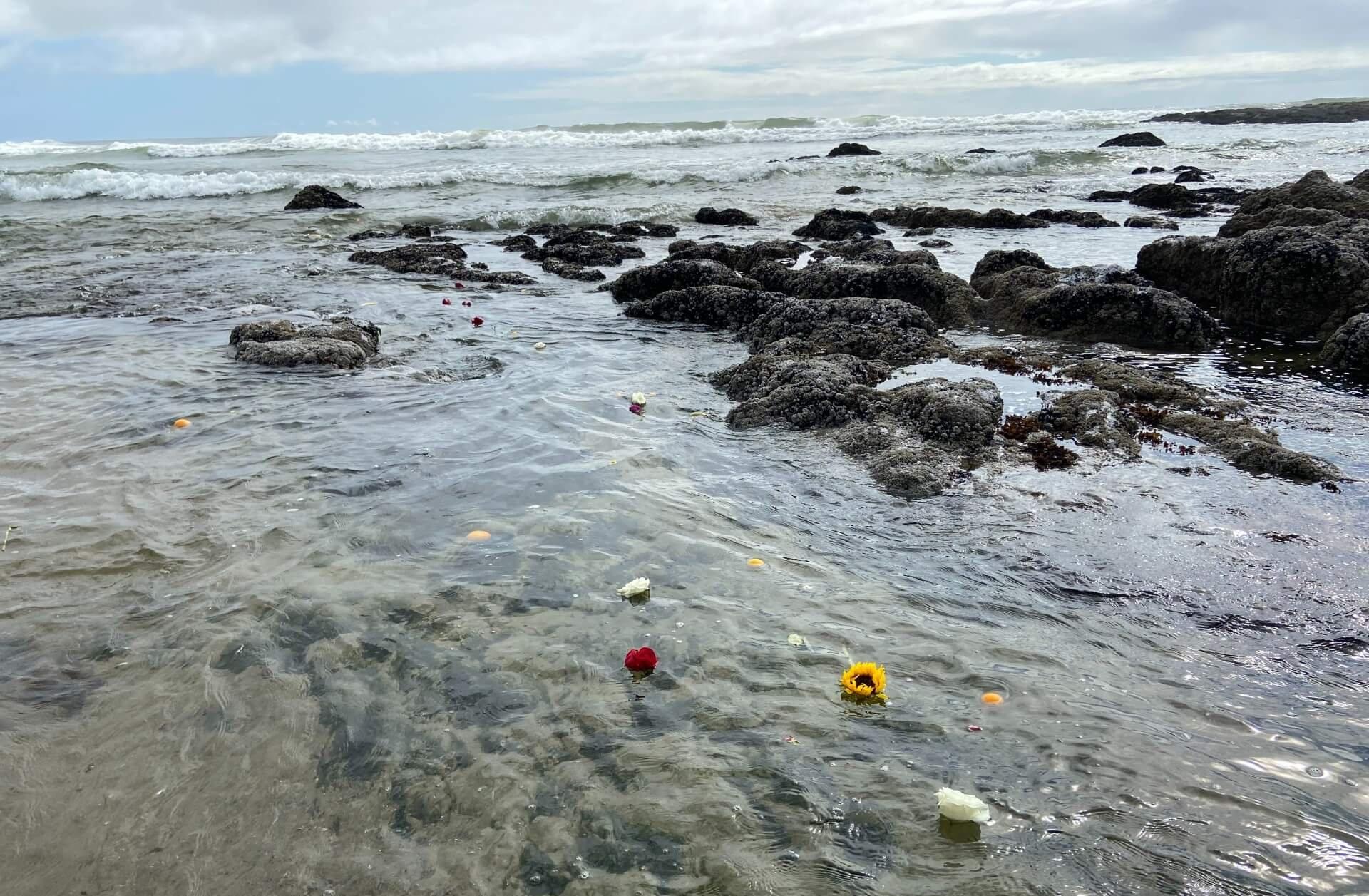 Ceremonial flowers in ocean waters