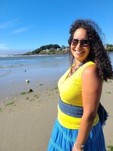Photo of Dr. Alaí Reyes-Santos near the ocean