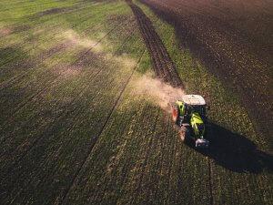 Tractor plowing a barren field