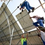 Image of workers building a solar array